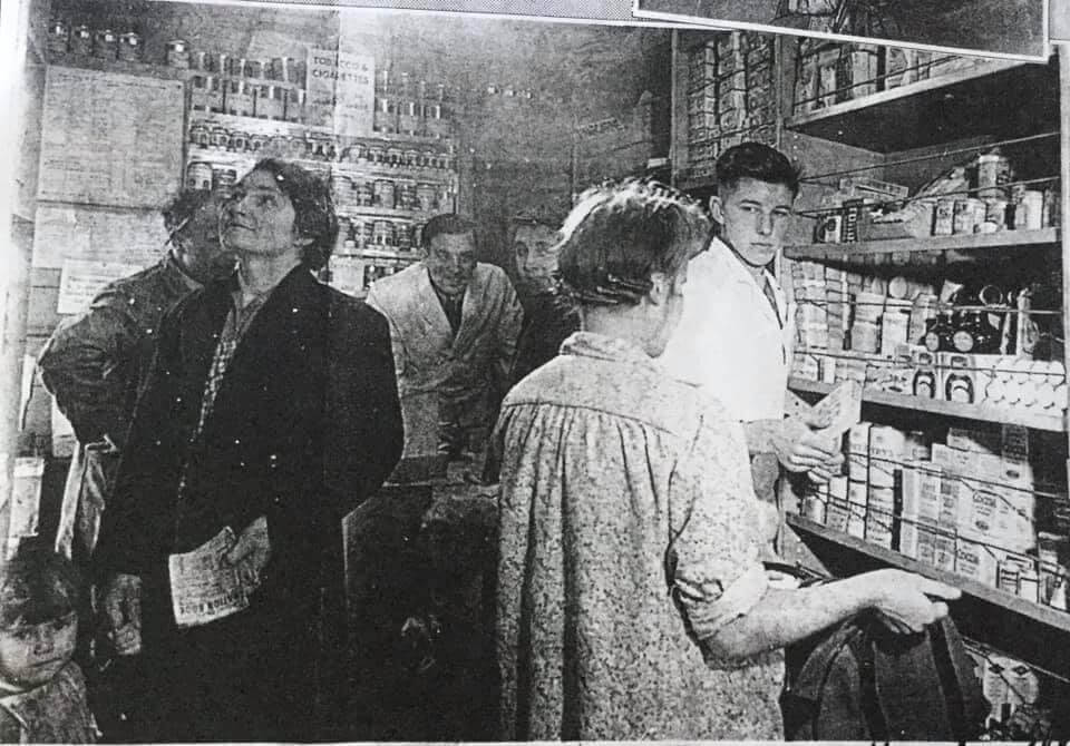 balck and white photo of people in a mobile grocery shop
