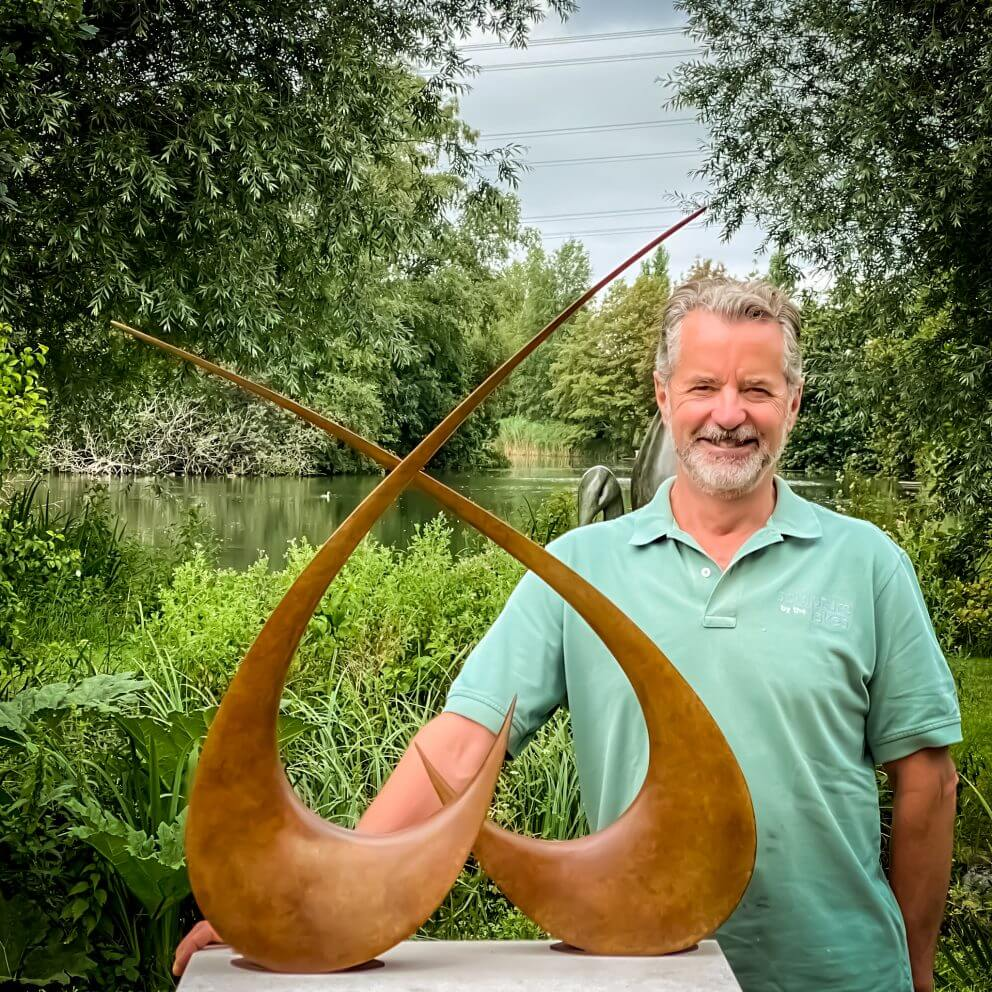 sculptor simon gudgeon poses with amorous to feature in edible Parsley Box Garden